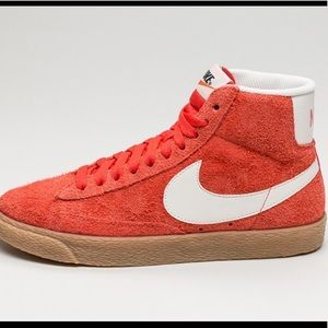 red/orange Nike blazers
